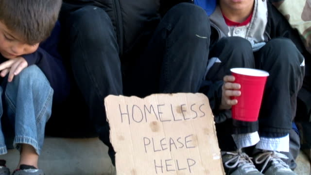 homeless family with signs - homelessness stock videos & royalty-free footage