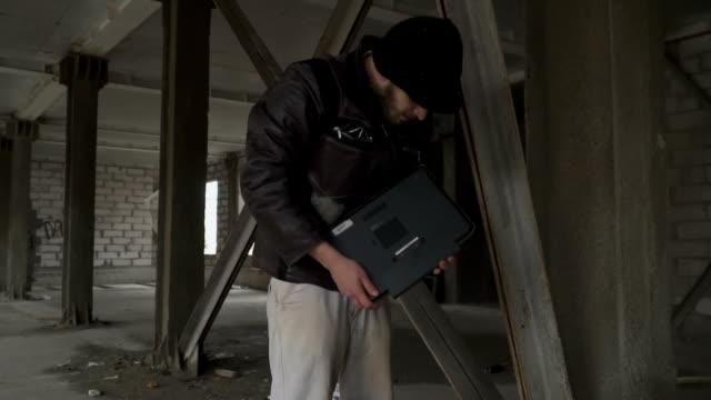 Homeless find laptop in garbage bag video