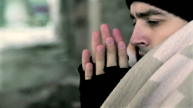 homeless heats his hands homeless heats his hands frozen stock videos & royalty-free footage