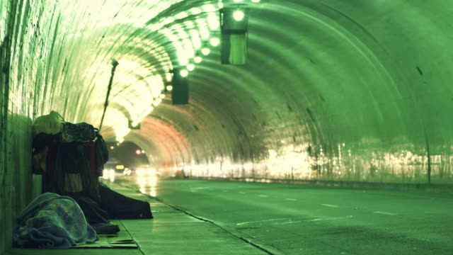 homeless in a tunnel time lapse - homelessness stock videos & royalty-free footage