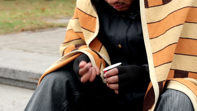 Homeless man counting money and thinking about his life, destitution, poverty video