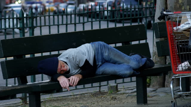 Homeless man sleeping on park bench HD 1080p: Homeless man sleeping on park bench homeless person stock videos & royalty-free footage