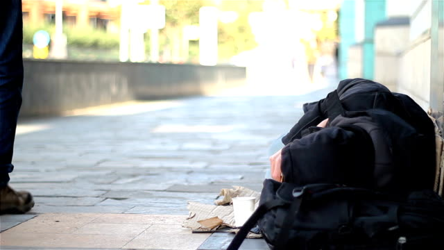 homeless man sleeping on the street - homelessness stock videos & royalty-free footage