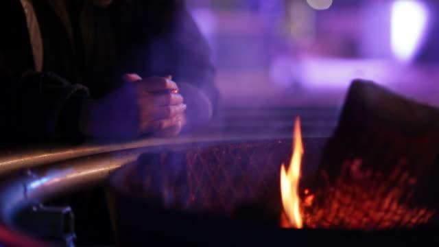 homeless man warming up video