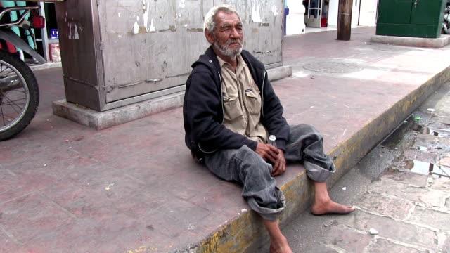 homeless man wide shot in Mazatlan Mexico video