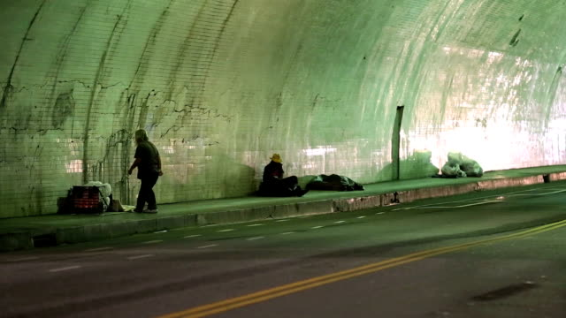 homeless men in city tunnel at night - homelessness stock videos & royalty-free footage