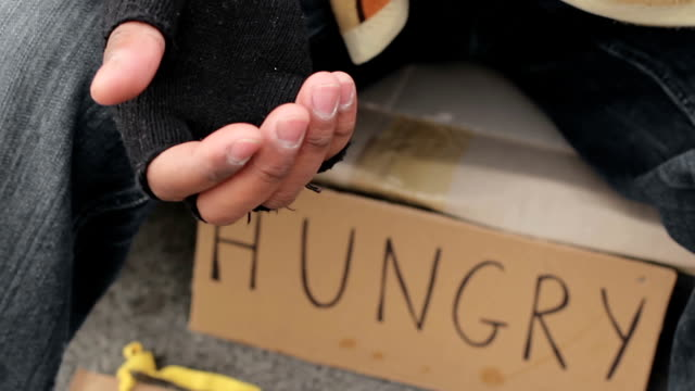 Homeless person begging with outstretched trembling hand, poverty and misery video