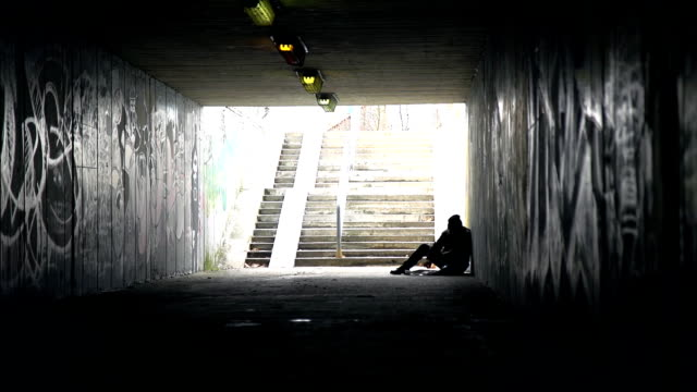 HD DOLLY: Homeless Person Eating In An Underpass video