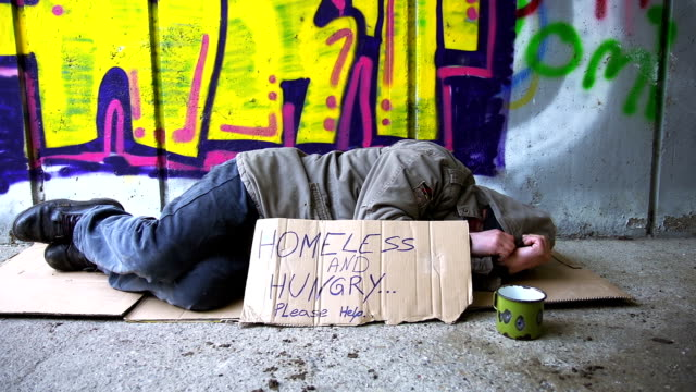 hd dolly: homeless person sleeping in the underpass - homelessness stock videos & royalty-free footage