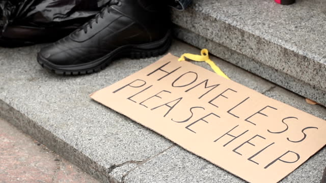 Homeless please help cardboard sign lying on the ground, homeless man begging video