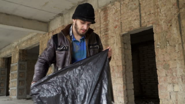 Homeless searches things in garbage bag video