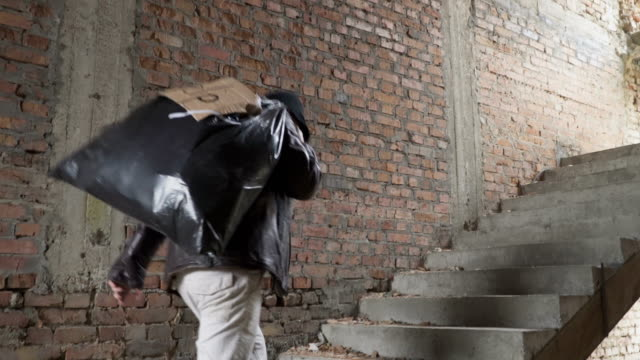 Homeless up stairs with garbage bag behind his back video