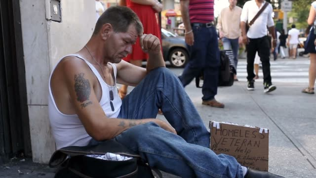homeless veteran sitting on sidewalk with sign sad homeless man in summer street with help sign veteran stock videos & royalty-free footage