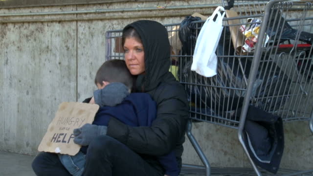 homeless woman holds son while begging - homelessness stock videos & royalty-free footage