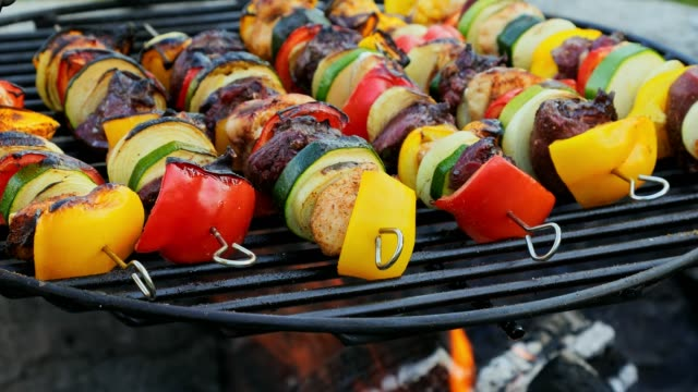 homemade and tasty skewers on grill with meat and vegetables in summer - spiedino video stock e b–roll