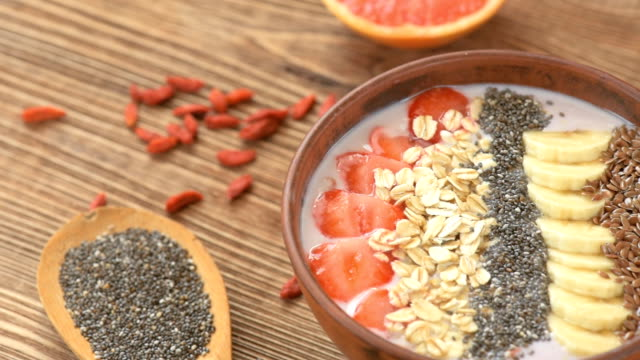 Homemade breakfast - fresh smoothie with fruits and seeds video
