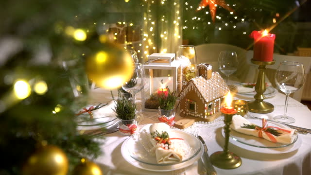 vídeos de stock e filmes b-roll de homemade christmas gingerbread house on a celebration table - christmas cooking