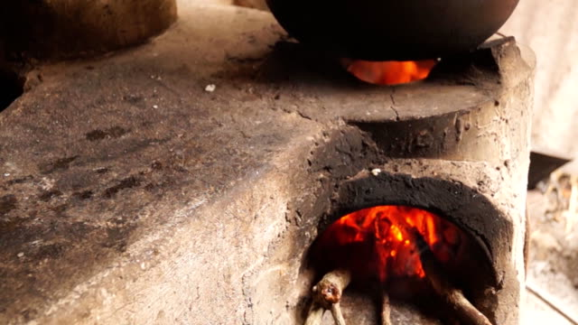 homemade concrete wood fired stove in the dirty kitchen