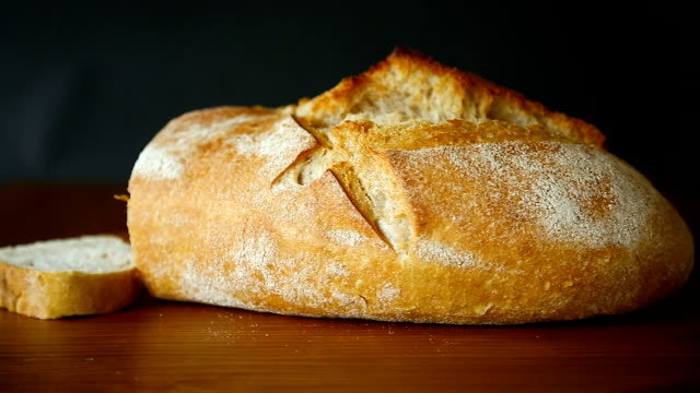 homemade fresh rye bread on a dark wooden table
