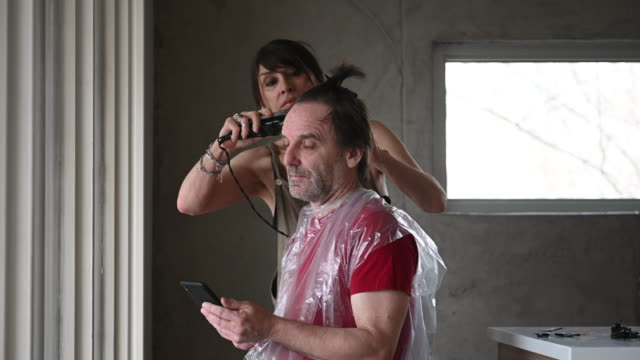 DIY Homemade HairCut Couple during Covid-19 part of a series stay home stock videos & royalty-free footage