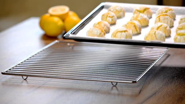 Homemade Lemon Crinkle cookies on baking sheet. video
