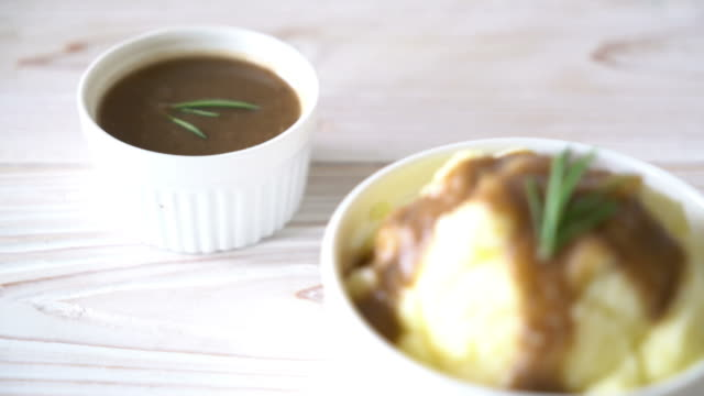 homemade mashed potatoes with gravy sauce