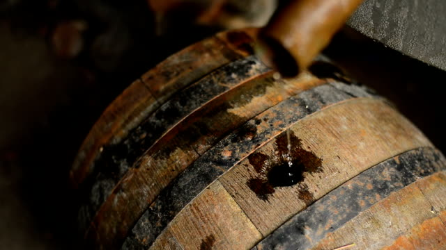 Homemade moonshine liquor Homemade moonshine liquor, homemade moonshine drips in wooden barrel. rye grain stock videos & royalty-free footage