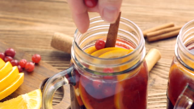 Homemade mulled wine with orange slices, cranberries, cinnamon . video