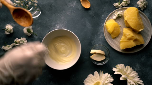 diy-homemade natural hand cream making-mixing natural ingredients - kosmetik stock-videos und b-roll-filmmaterial