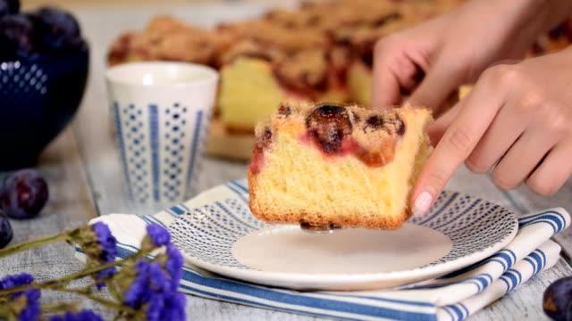 Homemade plum cake on wooden table.