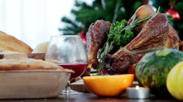 homemade roasted thanksgiving day festive tradition ideas concept delicious turkey with all the sides on wooden table - thanksgiving background stock videos & royalty-free footage