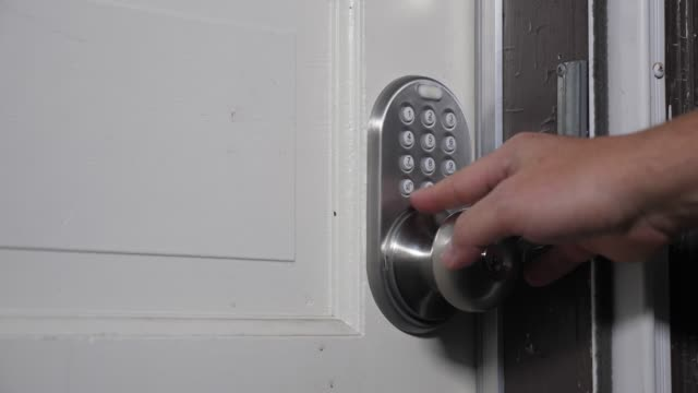 Homeowner Enters Passcode on Door for Entry video
