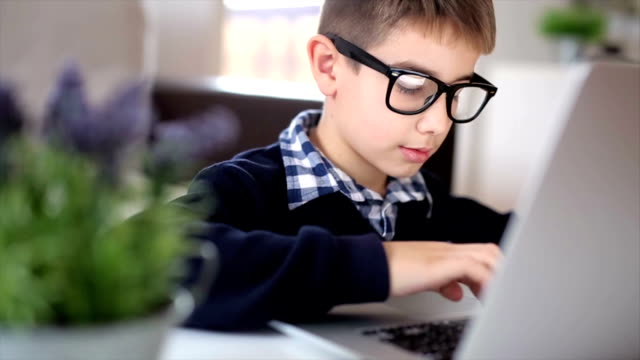 homework on the lap top - online learning stock videos & royalty-free footage