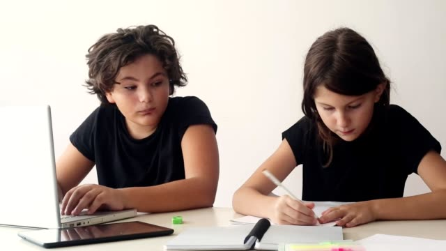 Homework Cousins doing homework together. cousin stock videos & royalty-free footage
