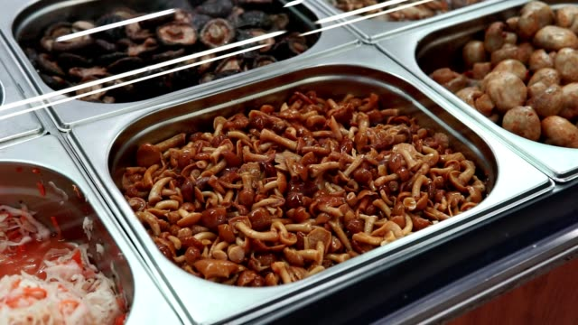 honey agaric pickled mushrooms on the shelves of a hypermarket, korean cuisine market - articoli casalinghi video stock e b–roll