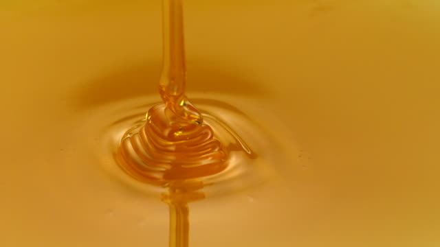 Honey pouring on comb, Slow Motion video