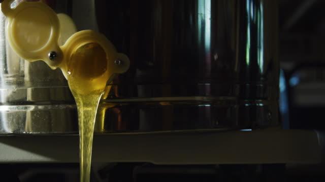 Honey Pours out a Spigot