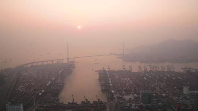 vídeos de stock e filmes b-roll de hong kong aerial v101 flying over lai chi kok area with shipyard views at sunset - neblina causada por temperatura elevada