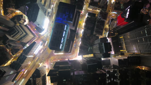 Hong Kong Aerial v130 Flying low over Causeway Bay downtown looking down vertically at night 2/17 Febuary 2017 china east asia stock videos & royalty-free footage