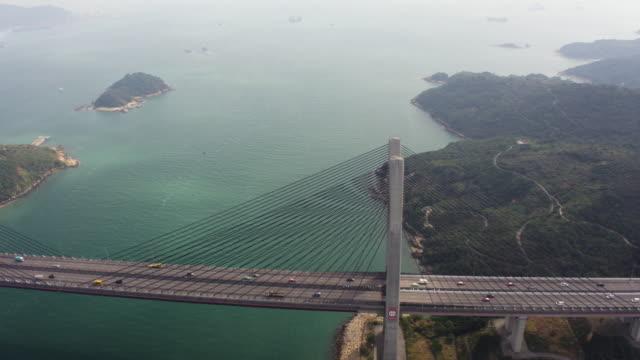 Hong Kong Aerial v163 Flying low besides Kap Shui Mun Bridge panning Febuary 2017 suspension bridge stock videos & royalty-free footage
