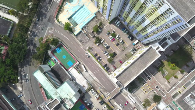 Hong Kong bird eye view of cityscape with high building and blue cloud sky - vídeo