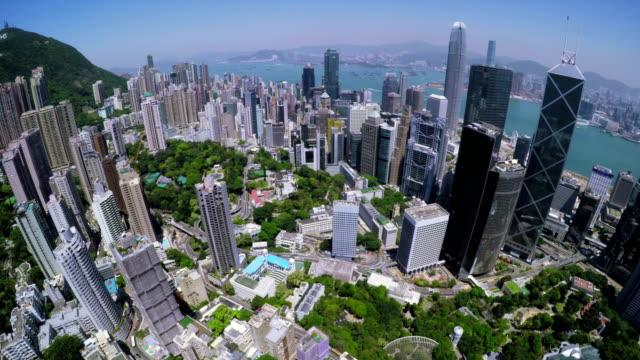 hong kong city aerial. beautiful clear blue sky. - hong kong video stock e b–roll