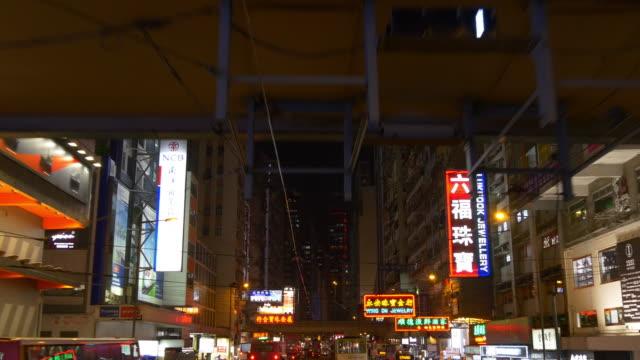 hong kong double decker tram ride crossroad up view panorama 4k china video