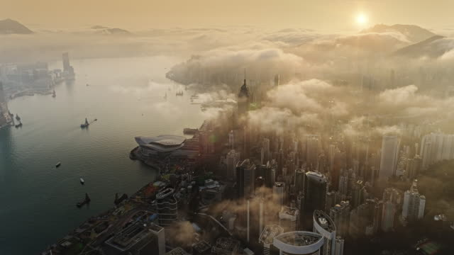 hong kong from air at sun rise - nebbia video stock e b–roll