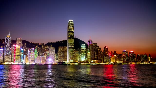 hong kong island skyline and victoria harbor at night view - luna park video stock e b–roll