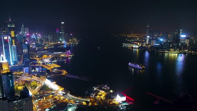 vídeos de stock, filmes e b-roll de porto de vitória de ilha de hong kong e kowloon aérea - paisagem urbana