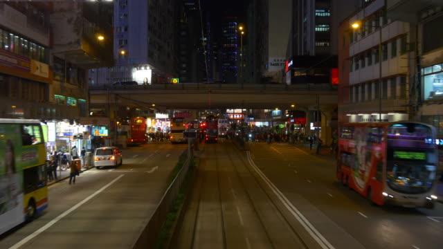 hong kong night time tram ride second floor street panorama 4k china video