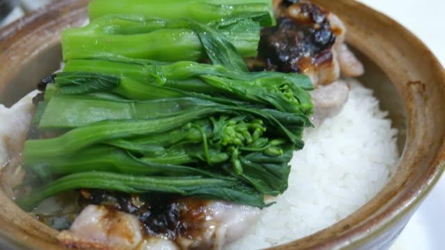 Hong Kong traditional dish of rice in clay pot video