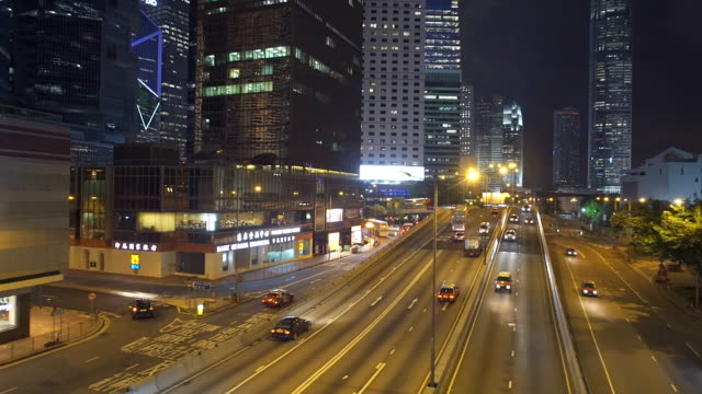 Hongkok traffic through modern city at night ,Panning video