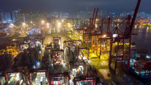 hongkong aerial drone hyper time lapse at container terminals and stonecutters bridge at night - struttura pubblica video stock e b–roll